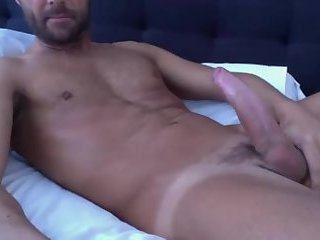 Cute older guy with tan lines plays with his dick