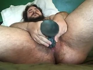 FTM bear works his toy into his hairy pussy
