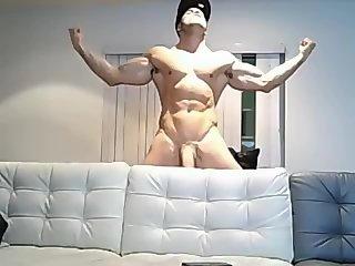 Muscle boy pulls his big uncut cock
