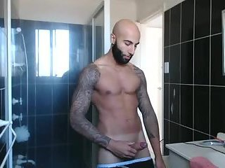 Hot fuck with sleaves jerks off in his bathroom