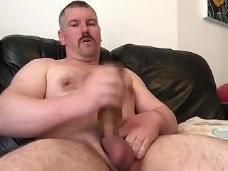 Beefy uncut stud fucks his toy