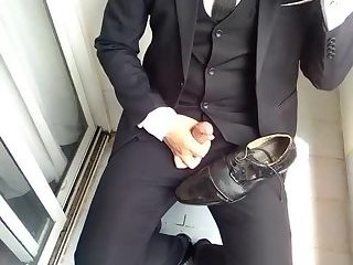 Young professional wanks onto his shoes