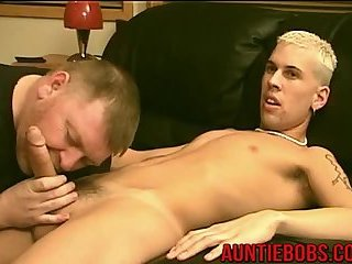 Sexy young stud gets his prick gobbled by mature fat twink