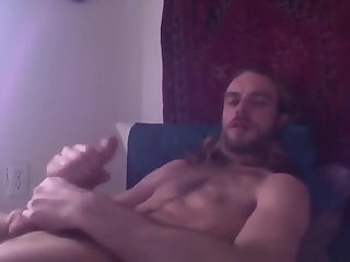 Stoner stud jerks his big cock to gay porn