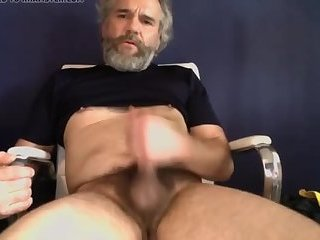 Mature hunk gives his cock a tugging