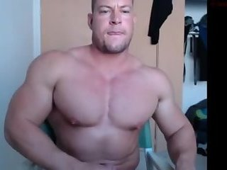 Muscle god poses and plays with his cock