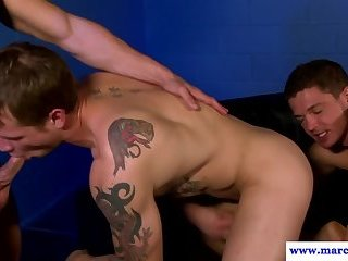 Inked muscular hunks fucking in gay threesome