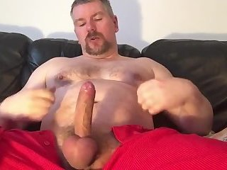 Dad plays with his uncut cock
