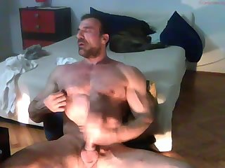 Strong mature hunk jerking off