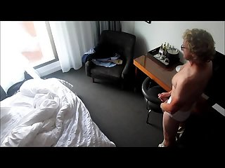Horny blond beats off in his hotel room