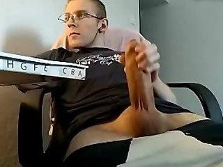 Lad strokes his huge uncut cock