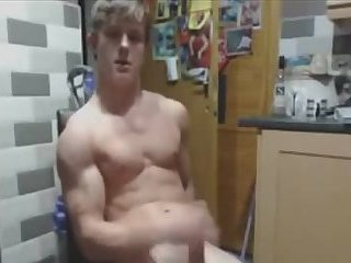 Young jock pounds one out in the kitchen
