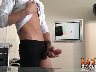 Tattooed Latino twink tugging and wanking his big fat cock
