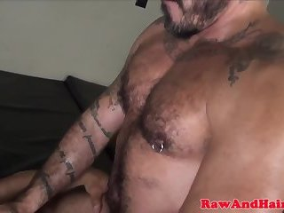 Inked wolf squirts cum while riding cock