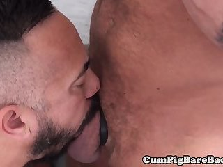Inked bear riding cock in the kitchen