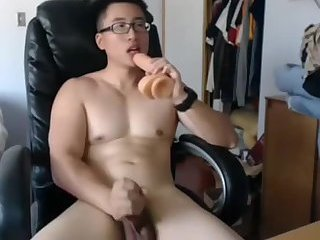 Beefy Asian guy  rides dildo and cums