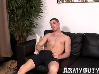 Hung soldier stud starts tugging to loosen up the stress