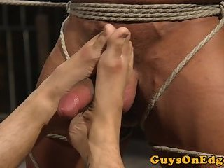 Gagged hunk edged during BDSM fetish