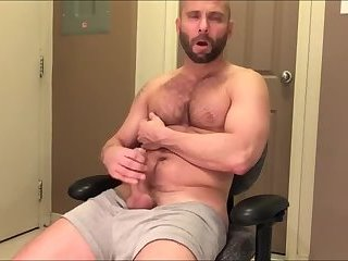 Sexy dilf gives his cock some attention