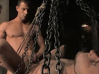 Sadomasochism poor twink in shiny catsuit fastened and poked