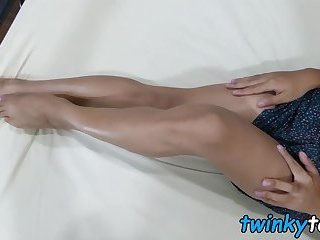 Asian twinkie plays with his hot feet and throbbing cock