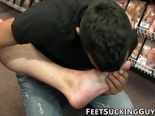 Handsome young man stuffs his mouth full of cock and feet