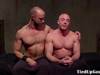 Gagged submissive stud gets restrained