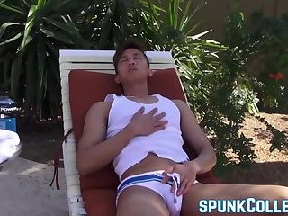 Good looking Asian twink wanks it by the pool and teases