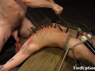 Restrained hunk spanked by muscular maledom