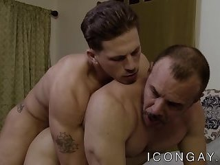 Hunky daddy fucks young jock before riding his cock