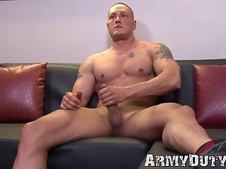 Dazzling inked army jock strokes his thick cock real hard