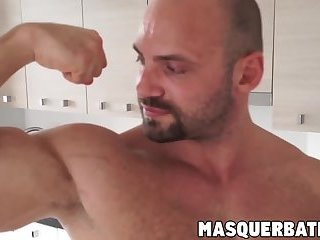 Muscular gay hunk playing with his big curved cock