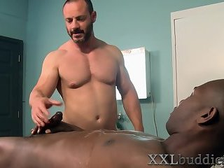 Bear blows big black cock