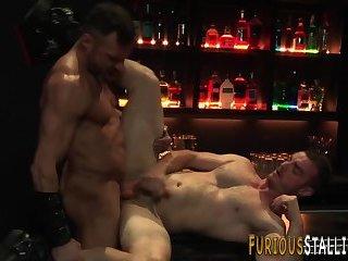 Muscled hunk fucks in bar