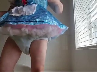 Diapered sissybaby in beautiful blue dress pissing and cumming