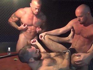 Gay hunk gets stuffed in gang bang