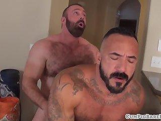 Muscly bears barebacking and tugging cocks