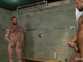 Two tattooed macho in the bathroom fuck fucked