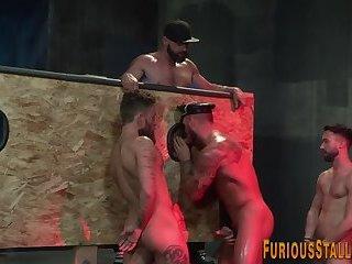 Gay bear gobbles cock