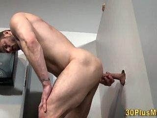 Dude blows gloryhole cock