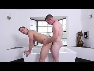 Hot jock gets a shoulder massage in the tub by handsome daddy before getting his bubble ass fucked.