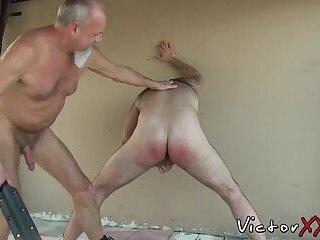 Gay grandpa spanks hairy ass before backyard bareback