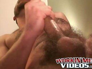 Handsome gay man stroking big cock before cumshot