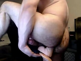 Handsome man shoves a 12-inches dildo up hairy moist ass cunt.