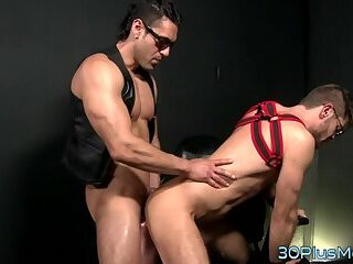 Aroused gay hunk riding