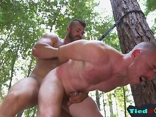 Hunky top assfucking his bound sub