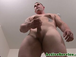 Muscular marine hunk wanking his dick