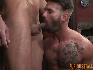 Muscled dude blows dong