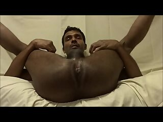 Indian crossdresser in female thong and bra playing with cock