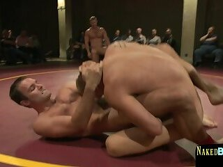 Muscular hunk dominated during wrestling